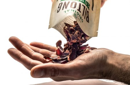 Original Biltong Company image of hand being held out to receive biltong.